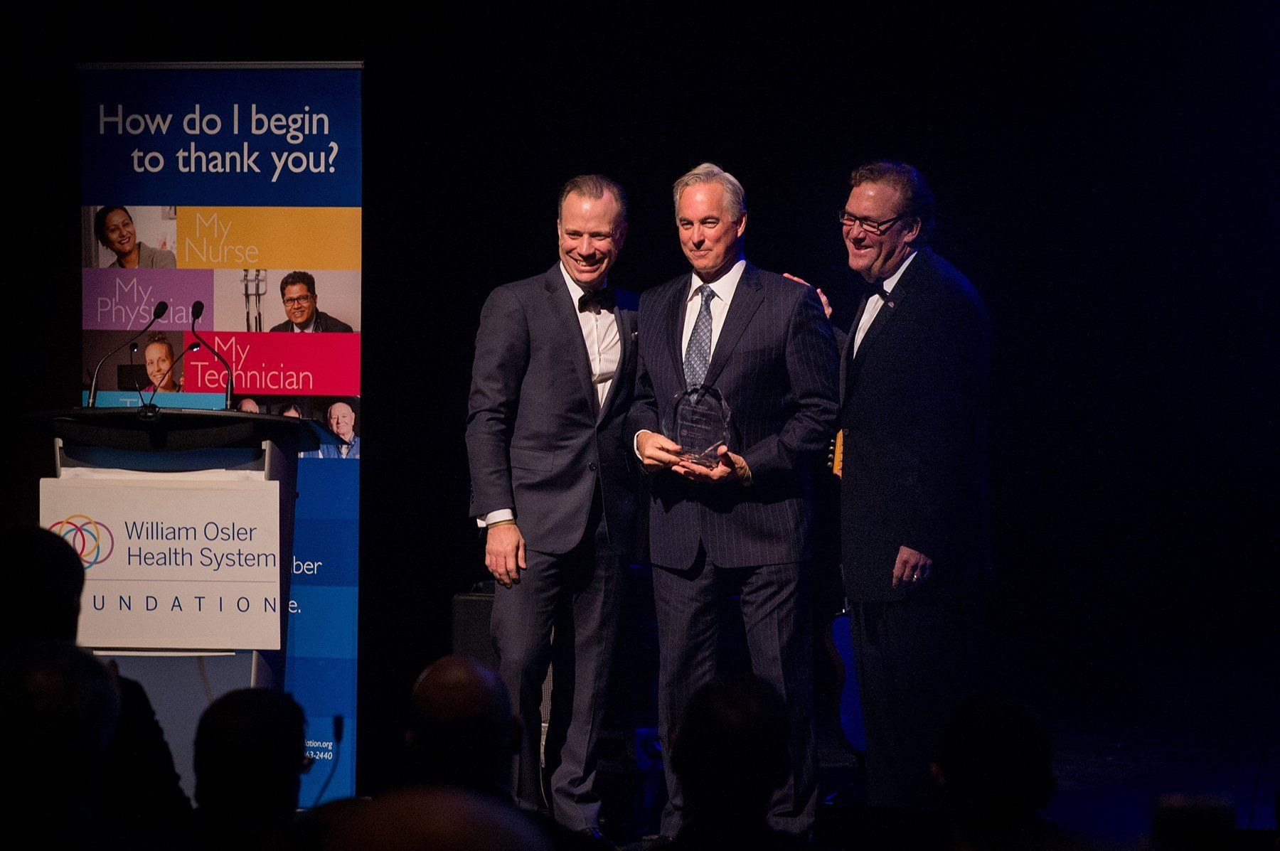 Ken Mayhew (right), president and CEO of William Osler Health System Foundation, presents John Esplen (centre), president and owner of Humberview Group, with Osler Foundation's Corporate Philanthropy Award in 2018 alongside Darren Steedman, vice-president, DG Group (left).